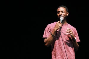 Opener AJ Foster performs stand-up during the Homecoming Comedy Show Tuesday night in Memorial Hall.