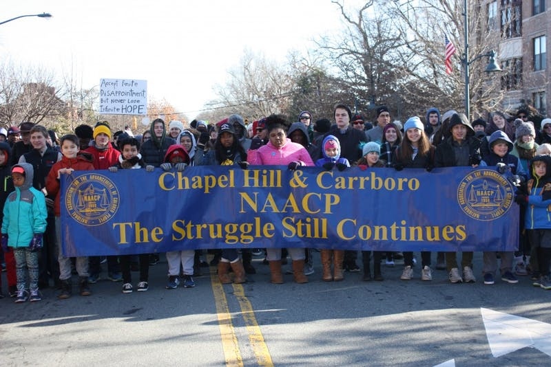 Attendees of the Chapel Hill-Carrboro NAACP MLK Day Rally and March walk down Franklin St. on Monday.