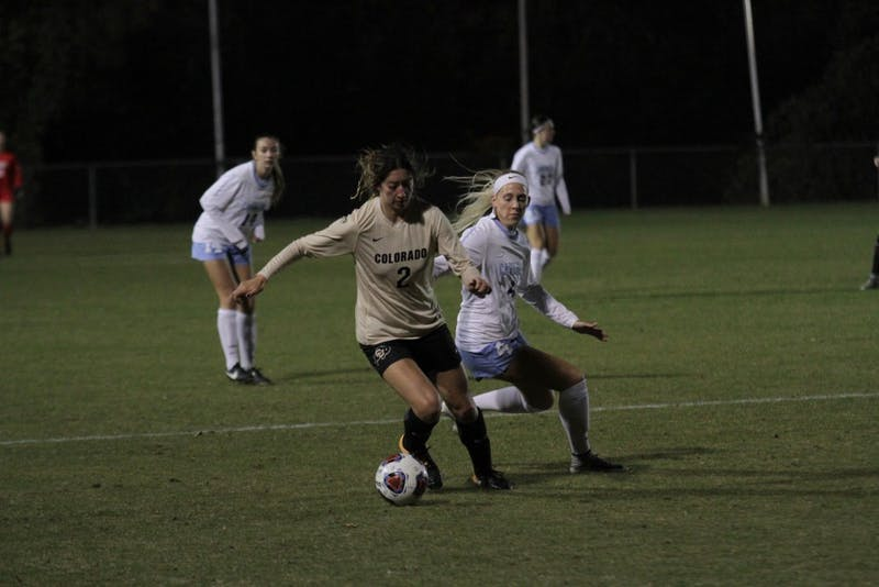 Forward Bridgette Andrzejewski fights for the ball against Colorado in an NCAA Tournament second round match on Friday in WakeMed Soccer Park in Cary.