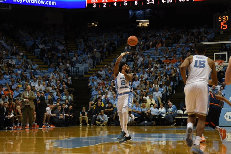 Guard Joel Berry II (2) throws a pass over his head against Bucknell on Nov. 15 in the Smith Center.