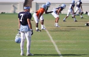 Senior wide receiver Austin Proehl watches practice in Kenan Stadium on Aug. 21.