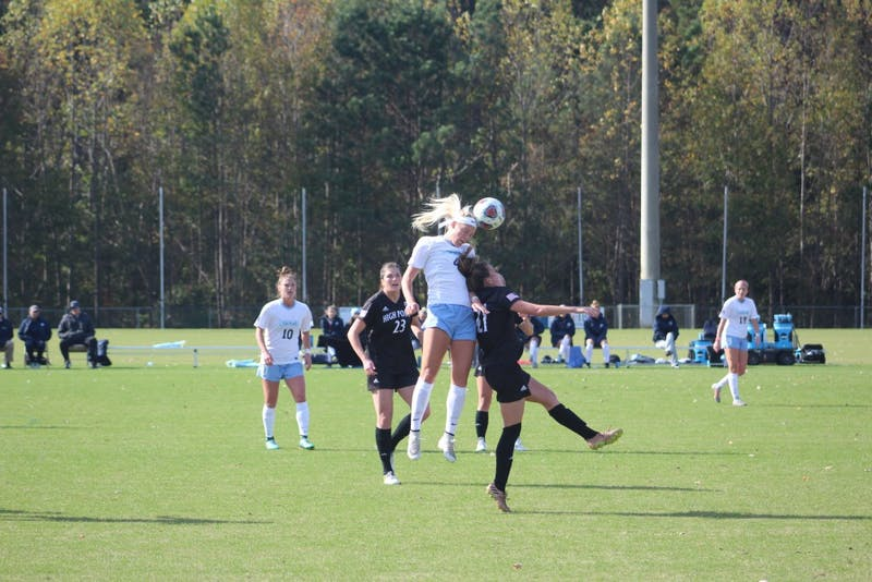 Sophomore Bridgette Andrzejewski (4) heads the ball after a goal kick during Saturday's game against High Point at WakeMed Soccer Park in Cary.