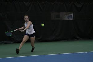 Sophomore Sara Daavettila prepares for a hit against Michigan on Feb. 18 in the Cone-Kenfield Tennis Center.
