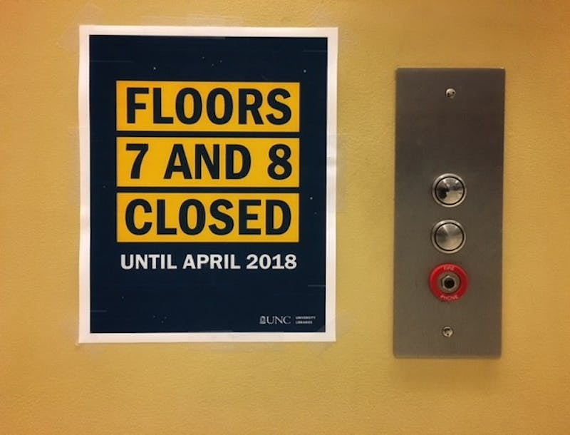 Signs in Davis Library regarding the construction project.