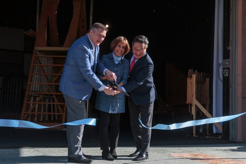 (From left) Chapel Hill Downtown Partnership Chairman Scott Maitland, Chancellor Folt, and CPA Executive and Artistic Director Emil Kang cut the ribbon for the new CURRENT ArtSpace + Studio.