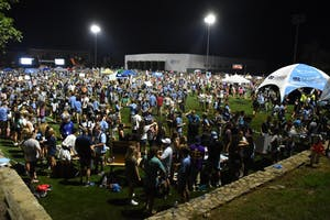 Students gather on Hooker Fields for FallFest on Sunday night. There, clubs and organizations sat at tables looking for new members.