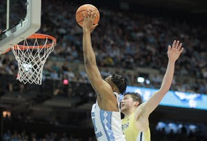Forward Sterling Manley (21) converts one of his three first-half dunks against Georgia Tech on Jan. 20 in the Smith Center.