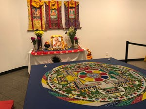A sand mandala was constructed by Tibetan monks across five days starting May 15 as part of the Sacred Arts tour.