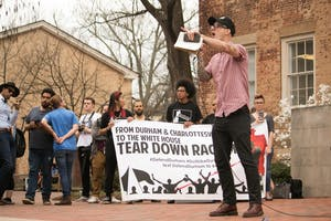 Asian studies professor Dwayne Dixon was among the faculty members receiving death threats from white supremacist groups. Dixon spoke during Wednesday's anti-fascism rally on UNC campus.