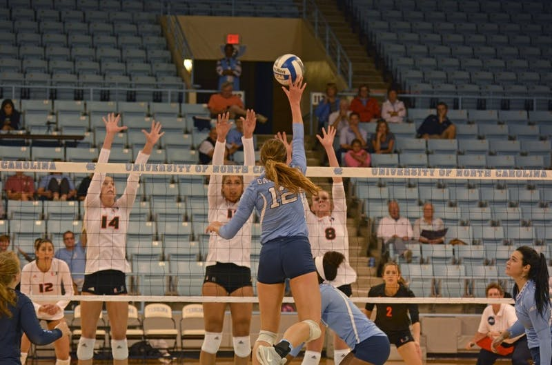 Julia Scoles (12) attacks against Miami during her first-year campaign in October 2016.