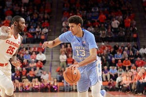 North Carolina guard Cameron Johnson (13) drives to the basket against Clemson on Jan. 30 in Littlejohn Coliseum.