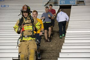 Individuals in ROTC and Chancellor Folt met at Kenan Memorial Football Stadium Monday morning to participate in a stair climb to commemorate 9/11.