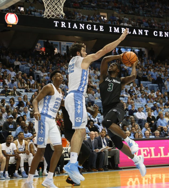 Forward Luke Maye (3) blocks the shot of Tulane guard Ray Ona Embo (3) during a Dec. 3 game in the Smith Center.