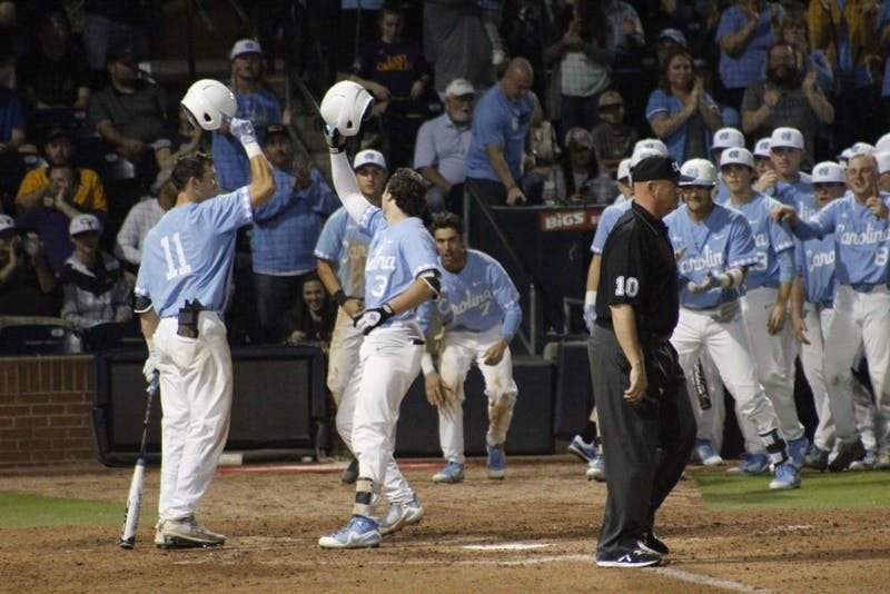 The team celebrates after Kyle Datres (3) hit a home run during Saturday's game against East Carolina University, where the Heels won 5-4.