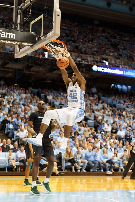 Forward Brandon Huffman (42) dunks home a ball against Tulane on Sunday in the Smith Center.