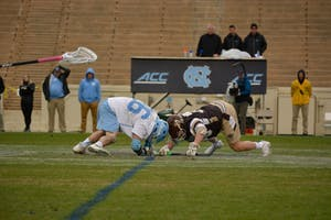 Junior midfielder Charles Kelly (26) faces off against Lehigh on Feb. 17 in Kenan Stadium.