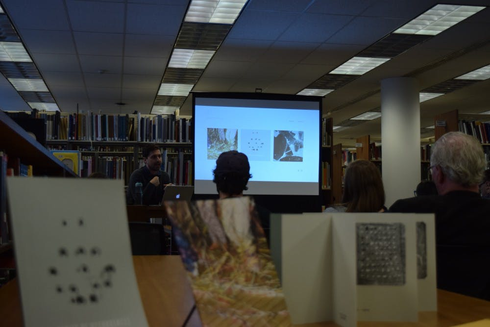 UNC alum and photographer, Ben Alper, talks to students about the art process