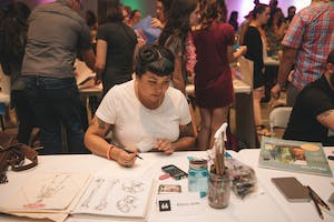 An artist creates an illustration at Monster Drawing Rally 2017.