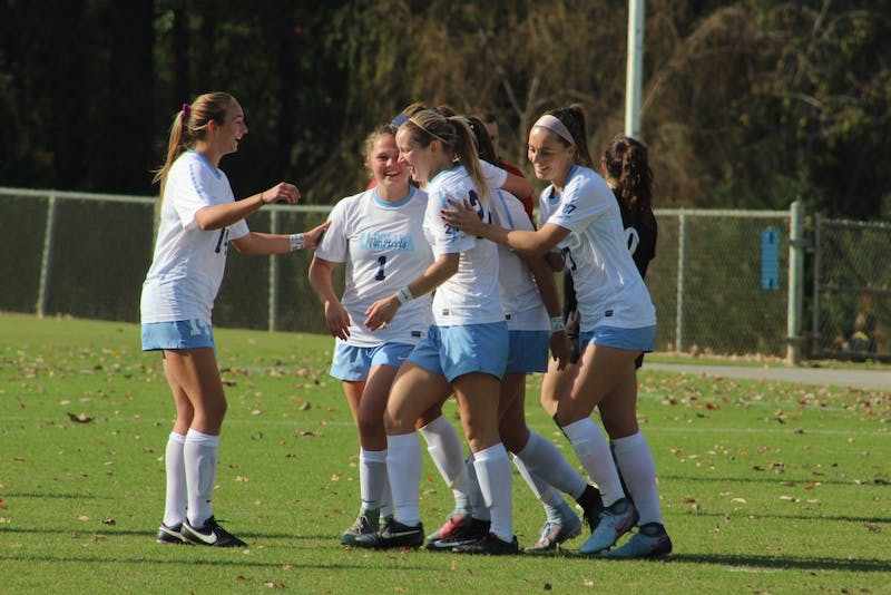The North Carolina women's soccer team celebrates its second goal of game against High Point on Saturday afternoon at WakeMed Soccer Park in Cary.