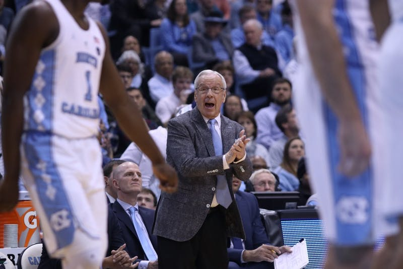 North Carolina head coach Roy Williams applauds his team during a Jan. 16 game against Clemson in the Smith Center.