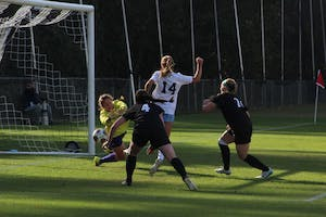 Sophomore Morgan Goff (14) scores the third and final goal in Saturday's game against High Point at WakeMed Soccer Park in Cary.