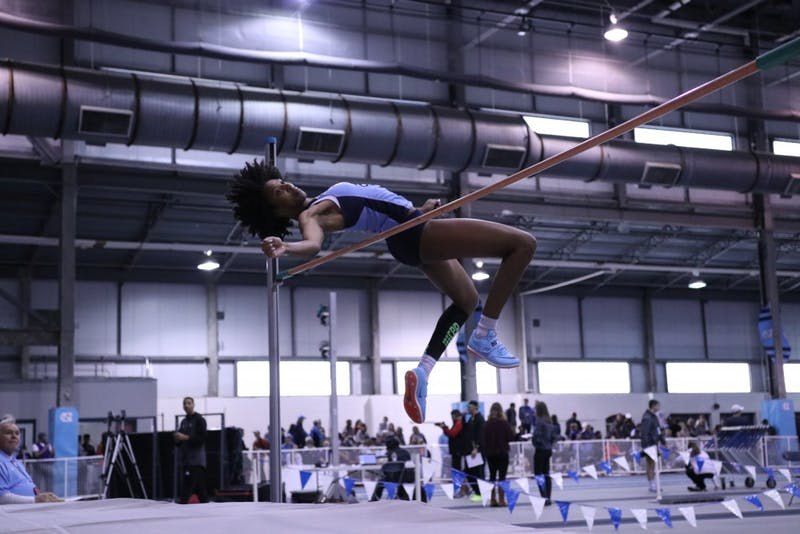 Nicole Greene competes in the high jump during the Dick Taylor Carolina Cup on Dec. 13 in Eddie Smith Field House.