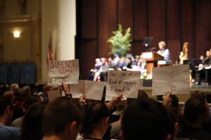 Students silently protest for Silent Sam's removal during the University Day Speech in Memorial Hall on Thursday afternoon.