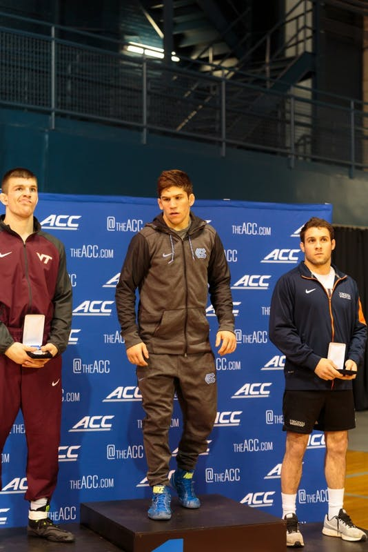 UNC redshirt senior Troy Heilmann waits at the podium after winning gold in the 149-pound class at the ACC Championship on March 3 at Carmichael Arena.
