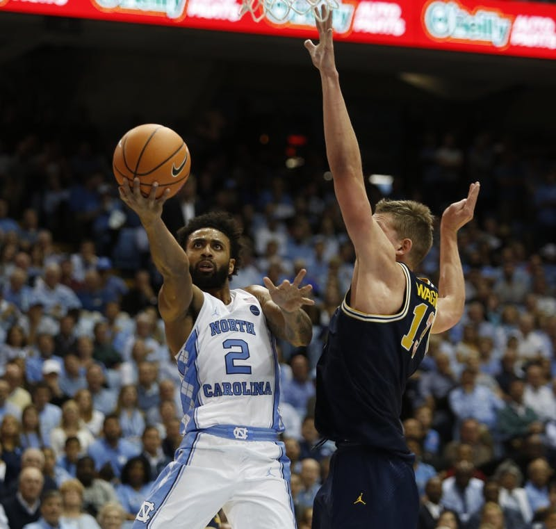 Guard Joel Berry II (2) goes up for a layup against Michigan's Moritz Wagner (13) during a Nov. 29 game in the Smith Center.