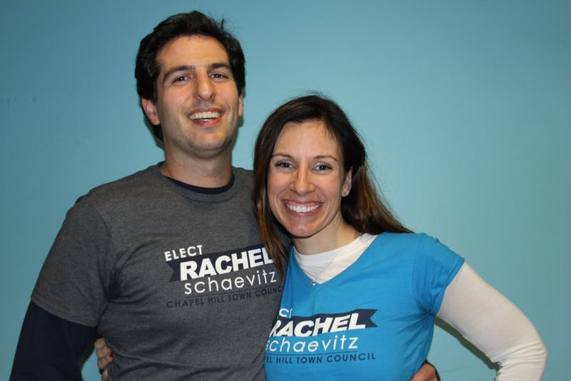 Rachel Schaevitz (right), joined by husband David Shaevitz (left), celebrated a win in the election for Chapel Hill Town Council on Tuesday, Nov. 7, 2017.