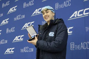 Carolina Hauder breaks the school record for the 100-yard backstroke on Day 3 of the 40th annual Atlantic Coast Conference Women's Swimming and Diving Championships in Greensboro.