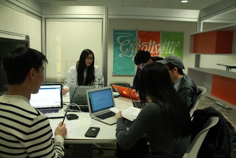 A group of students work together on homework in the underground of the Union.