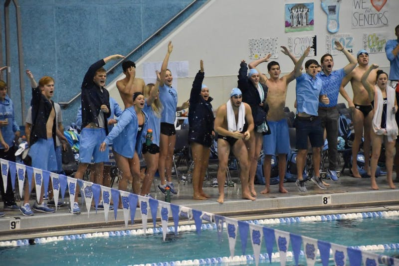 North Carolina swimmers cheer on their teammates during the team's senior meet against N.C. State on Jan. 26 in Koury Natatorium.