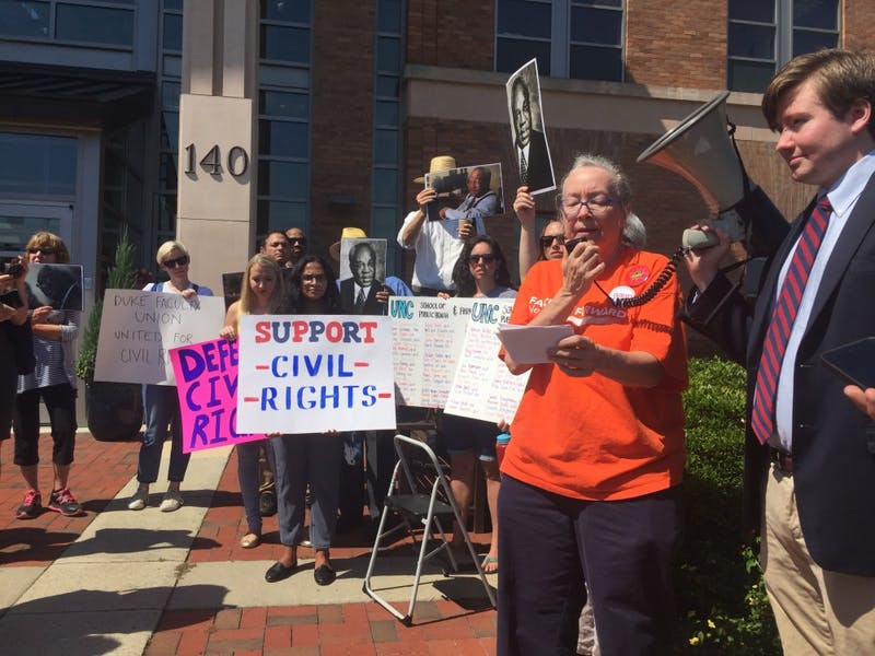 Altha Carvey, UNC professor of geography, speaks in protest of the litigation ban against the Center for Civil Rights.