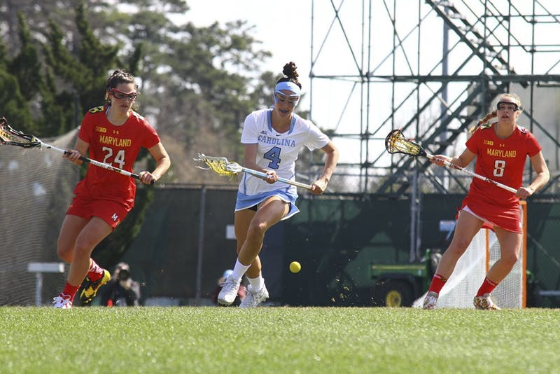 Marie McCool (4) runs past Maryland defenders to secure a ground ball on Feb. 27, 2016 at Fetzer Field.