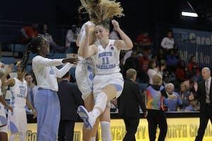 Sophomore Emily Sullivan (11) celebrates with her teammates in North Carolina's win over Radford in Carmichael Arena.