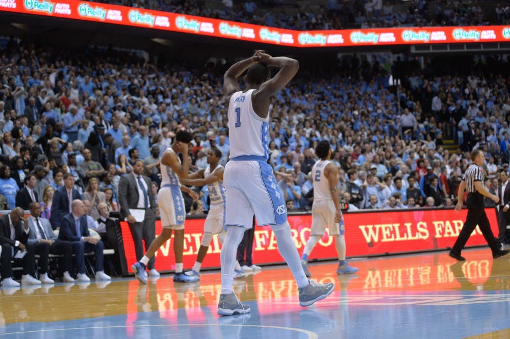Theo Pinson's career day not enough as N.C. State upsets No. 10 UNC, 95-91, in overtime