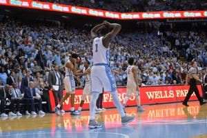 Forward Theo Pinson (1) puts his hands over his head in frustration during UNC's 95-91 overtime loss to N.C. State on Jan. 27 in the Smith Center.