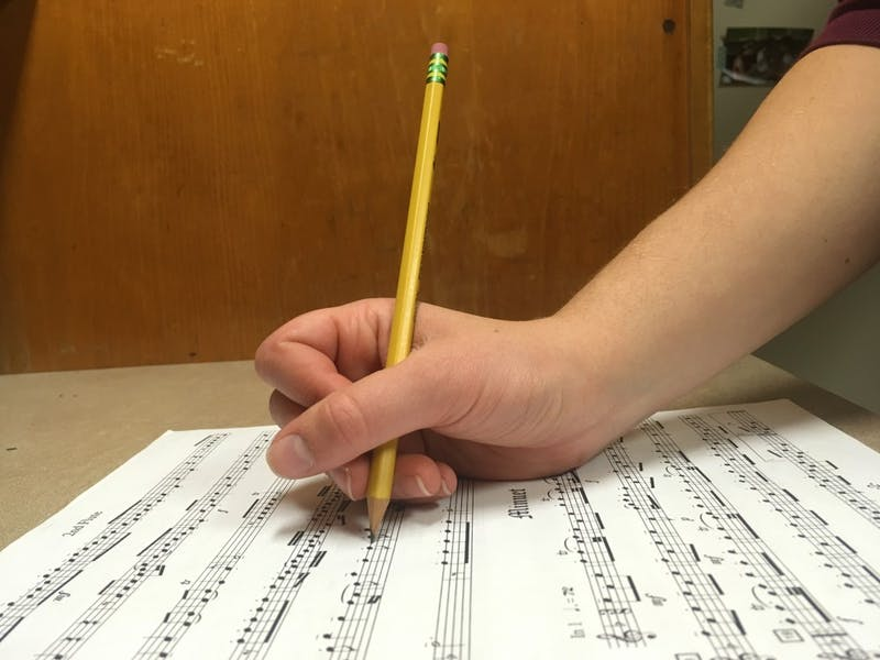 Sophomore Barbara Ramsdell writes on sheet music in Avery Residence Hall on Sunday, April 8, 2018. Photo courtesy of Annie Bennett.