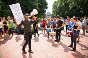 A noise demonstration was held outside South Building on Wednesday afternoon. Demonstrators used drums, pots, pans and noise makers to protest the Silent Sam statue on campus.
