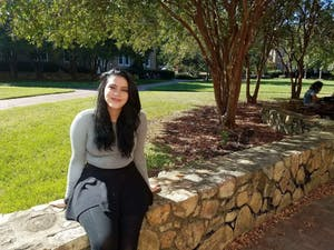 Jamie Ramos, a senior information science major and first-generation student, sits on the quad near Manly and Mangum. Photo courtesy of Mohamed Lansari.