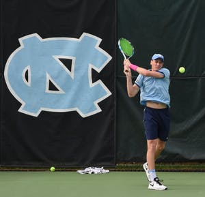 North Carolina men's tennis player Blaine Boyden takes a backhand.