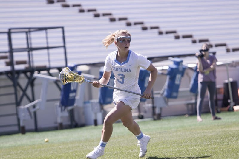 First-year attacker Jamie Ortega (3) advances the ball against Notre Dame on March 31 in Kenan Stadium.
