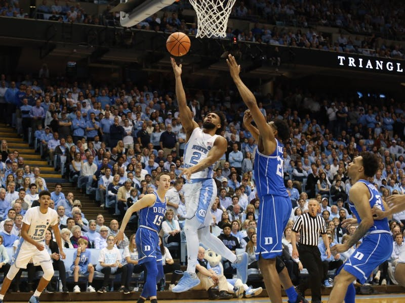 North Carolina guard Joel Berry II (2) takes a lefty layup over Duke center Marques Bolden (20) on Thursday night in the Smith Center.