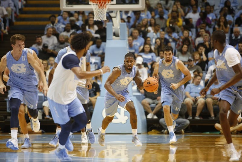 Seventh Woods dribbles the ball up court during a scrimmage at Late Night With Roy on Friday night.