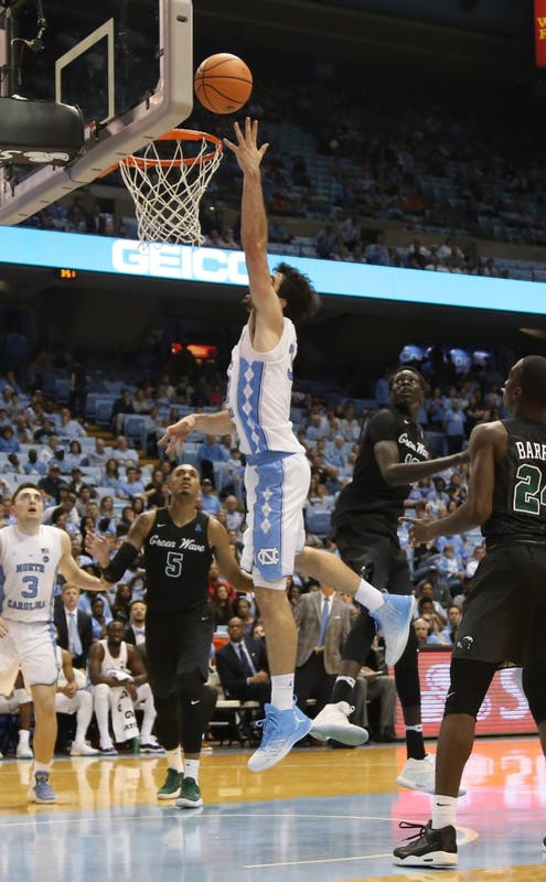Forward Luke Maye (3) makes a lefty layup against Tulane on Dec. 2 in the Smith Center.