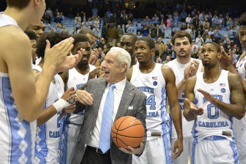 Head coach Roy Williams celebrates with his team after winning his 400th game at UNC against Bucknell on Nov. 15 in the Smith Center.