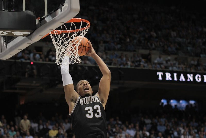 Wofford forward Cameron Jackson (33) elevates for a dunk against North Carolina on Dec. 20 in the Smith Center.