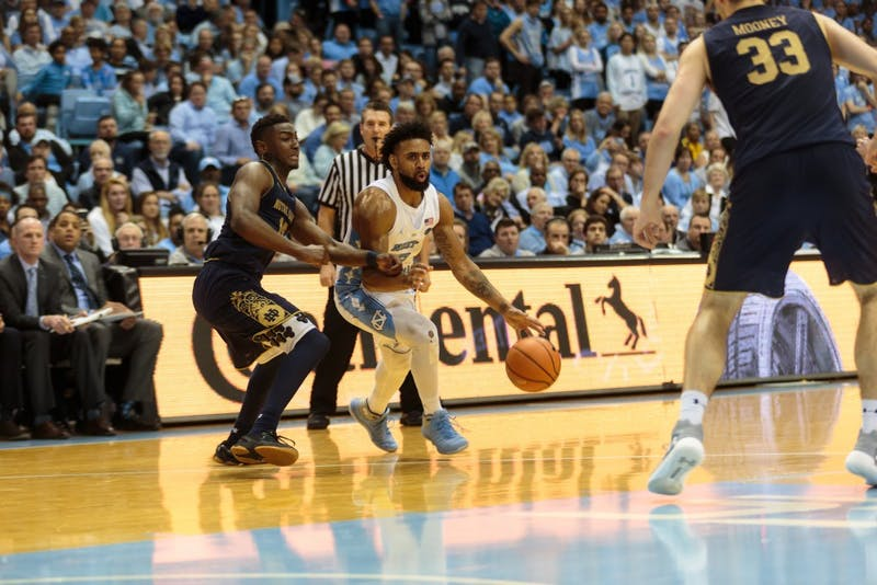 Guard Joel Berry II (2) dribbles past a Notre Dame defender during UNC's 83-66 win over the Fighting Irish on Feb. 12 at the Smith Center.