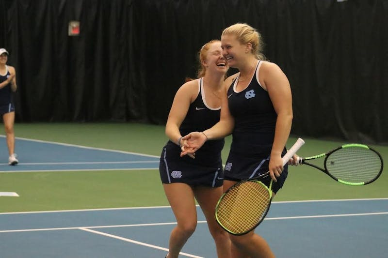 UNC senior Sara Daavaettila and first-year Alle Sanford celebrate their doubles victory over Vanderbilt.